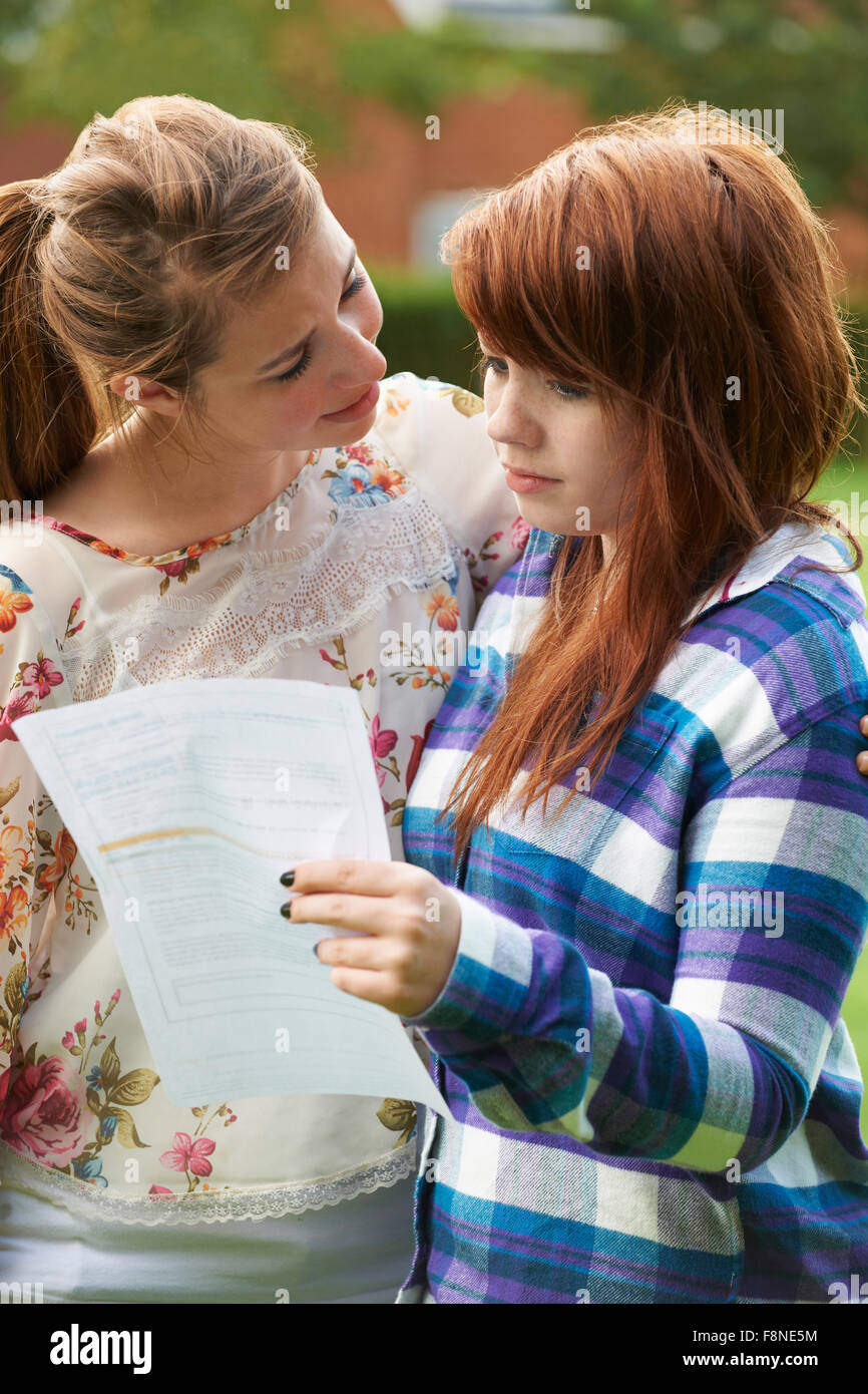 Teenage Girl Consoles Friend Over Bad Exam Result - Stock Image