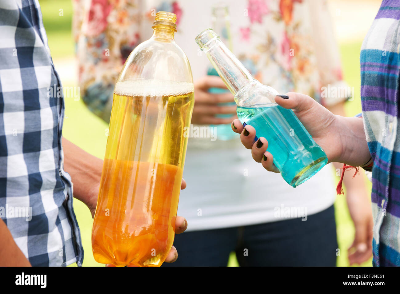 Group Of Teenagers Drinking Alcohol - Stock Image