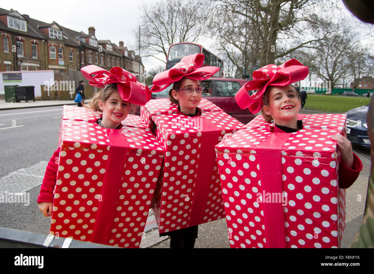 Three cheerful girls in homemade fancy dress costumes for the jewish three cheerful girls in homemade fancy dress costumes for the jewish holiday of purim in stamford hill london 5 march 2015 solutioingenieria Images