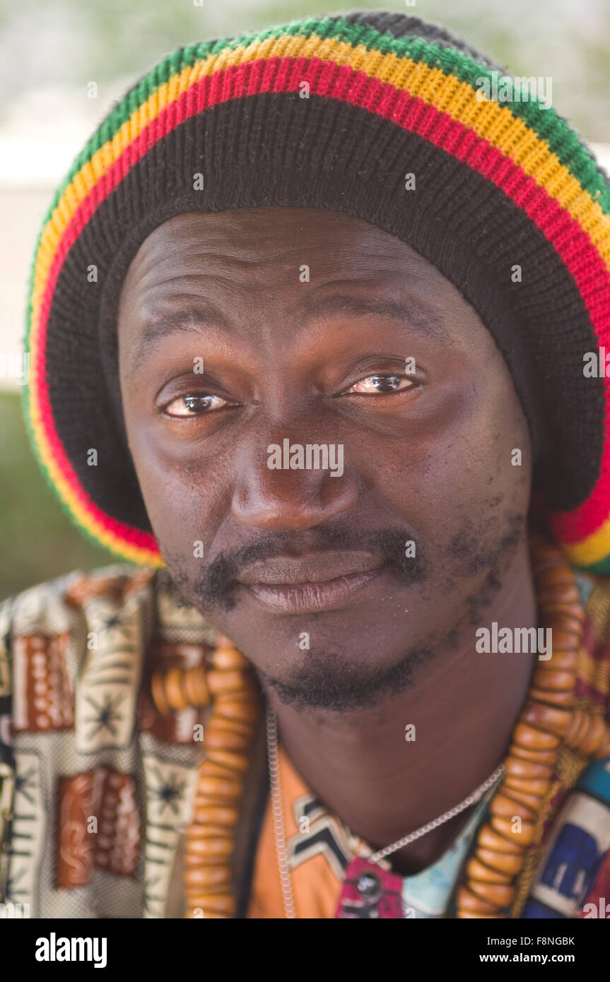Senegalese man in reggae style Jamaican rasta cap and Baye Fall prayer beads on the island republic of Cape Verde - Stock Image