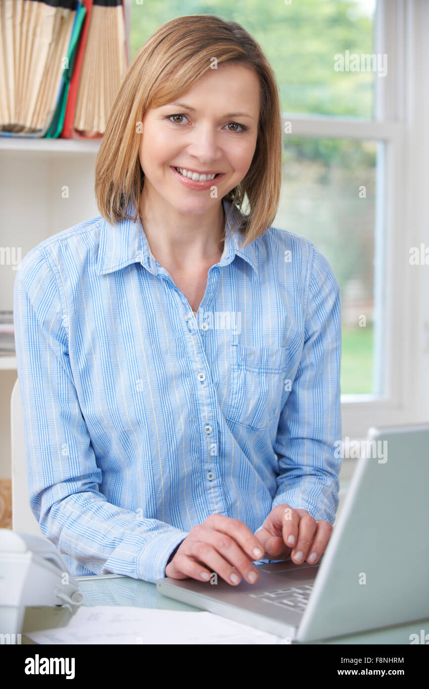 Woman Using Computer In Home Office - Stock Image