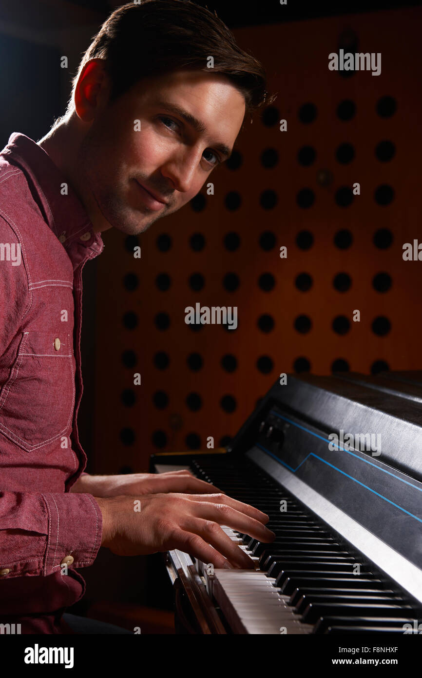 Musician Playing Electric Piano In Recording Studio - Stock Image