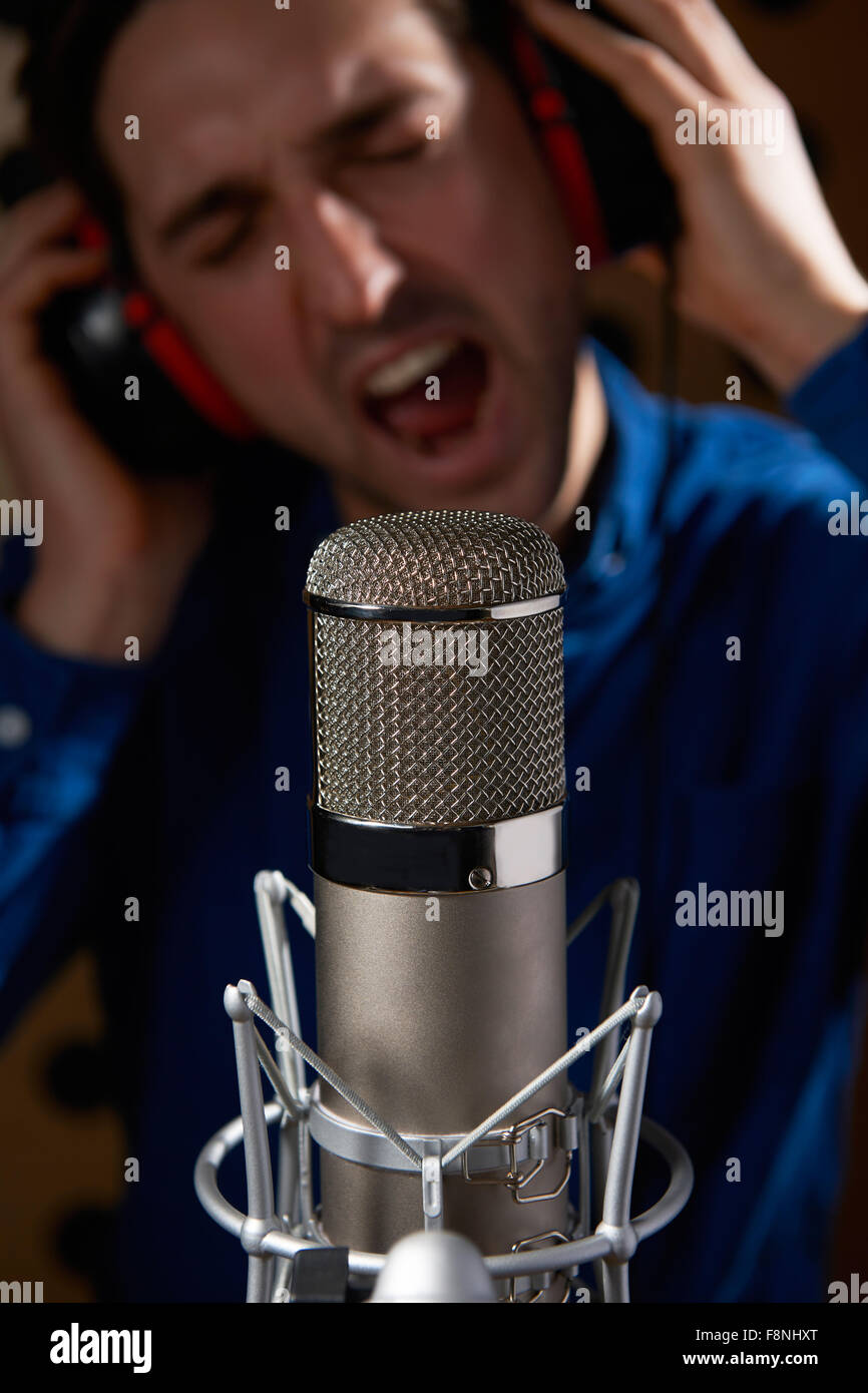 Male Vocalist In Recording Studio - Stock Image