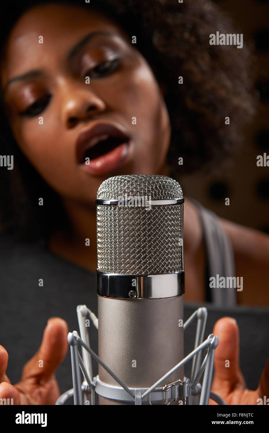 Female Vocalist In Recording Studio - Stock Image