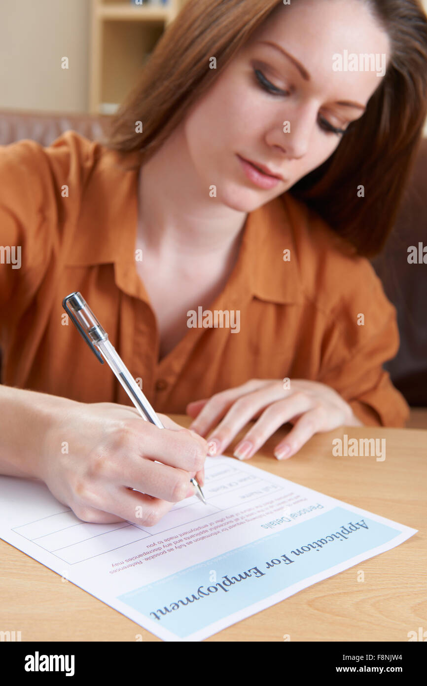 Young Woman Completing Employment Application Form - Stock Image