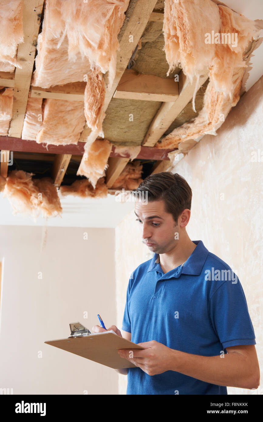 Builder Preparing Quote For Leak In Ceiling - Stock Image