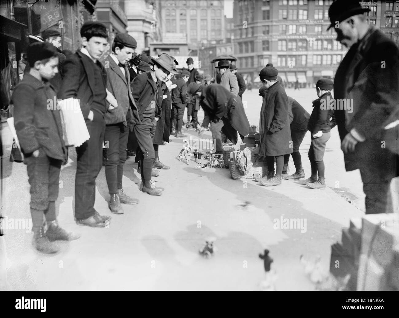 Group of Gutter Toy Merchants and Young Boys, New York City, USA, 1903 - Stock Image