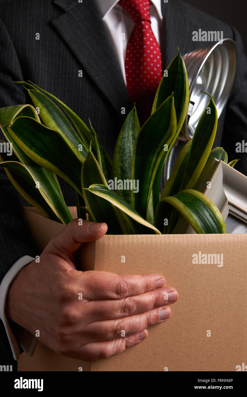 Redundant Businessman Carrying Possessions In Box - Stock Image