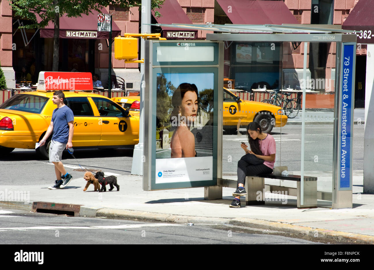 A Cindy Sherman fine art photograph is reproduced on a bus shelter advertising panel in New York  City as part of Stock Photo
