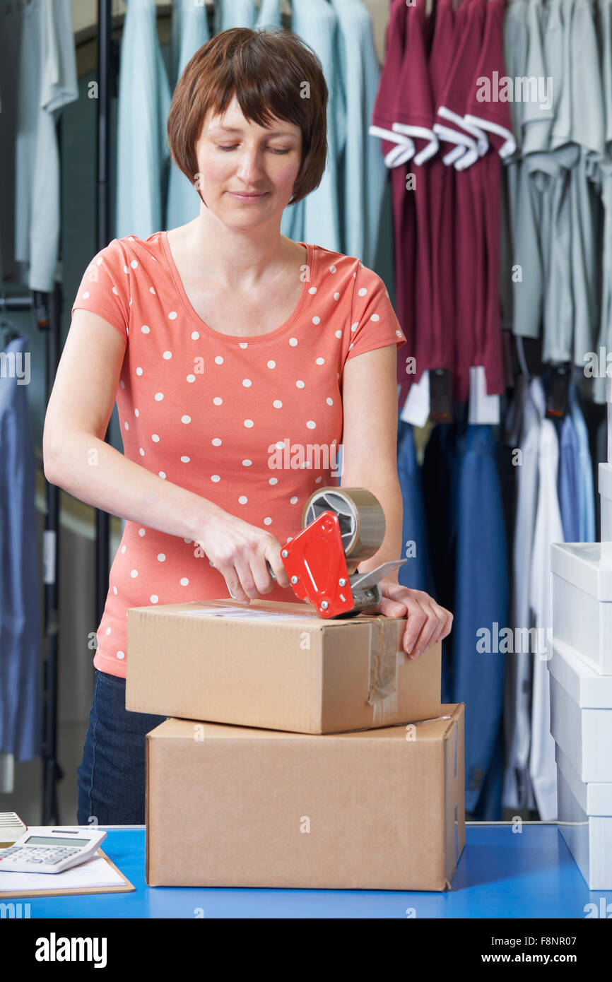 Woman Running On line Clothing Business - Stock Image