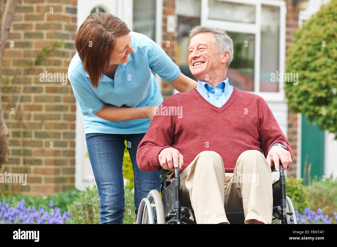 Carer With Senior Man In Wheelchair - Stock Image
