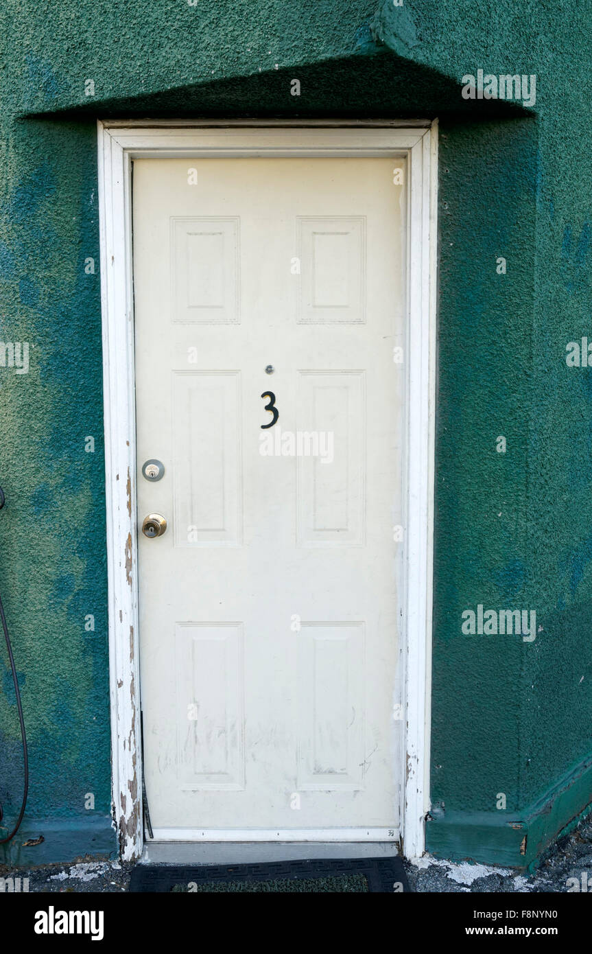 Apartment Number Three 3 On A White Door   Stock Image