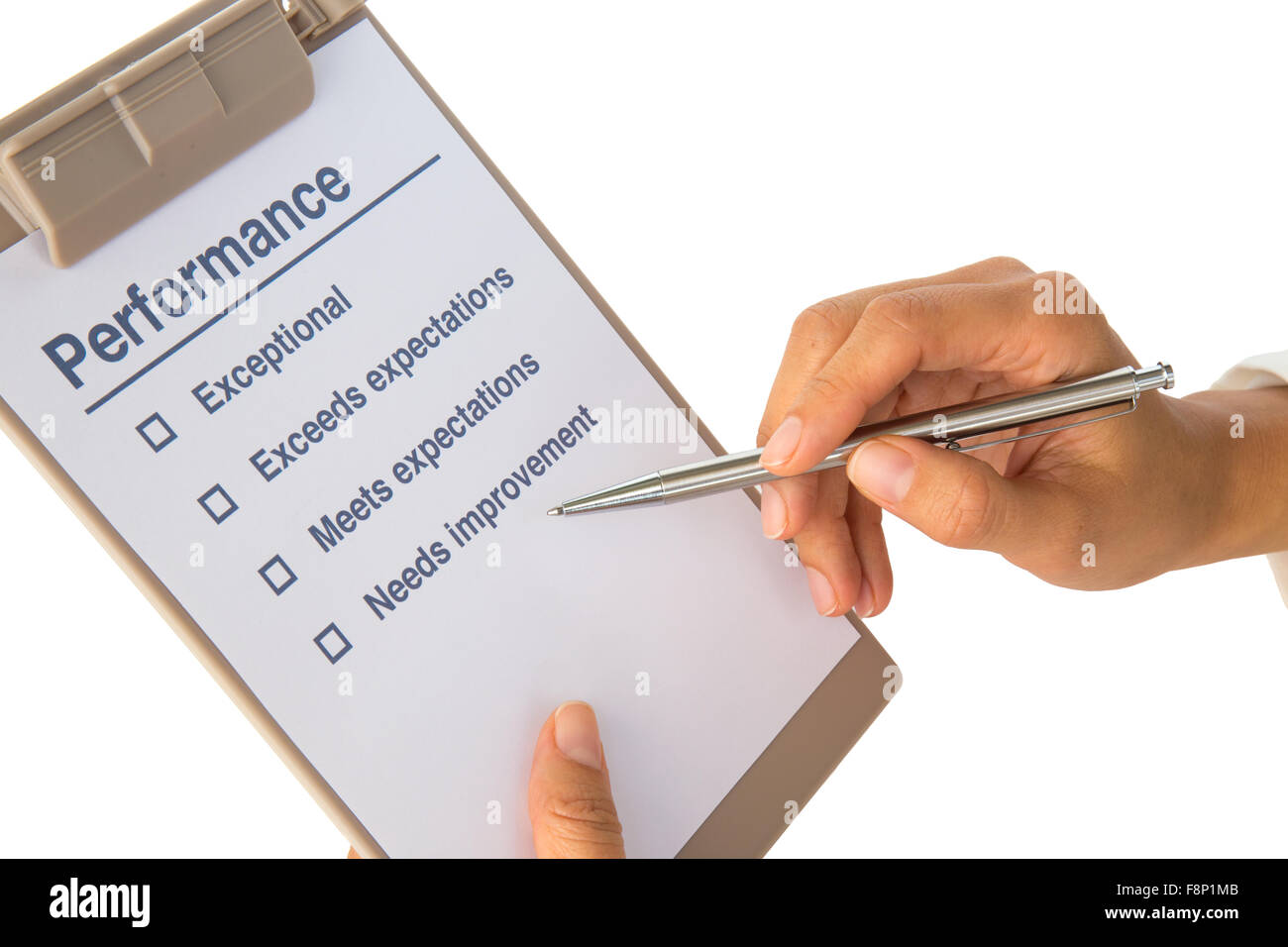 Woman's hand fills out performance checklist on white - Stock Image
