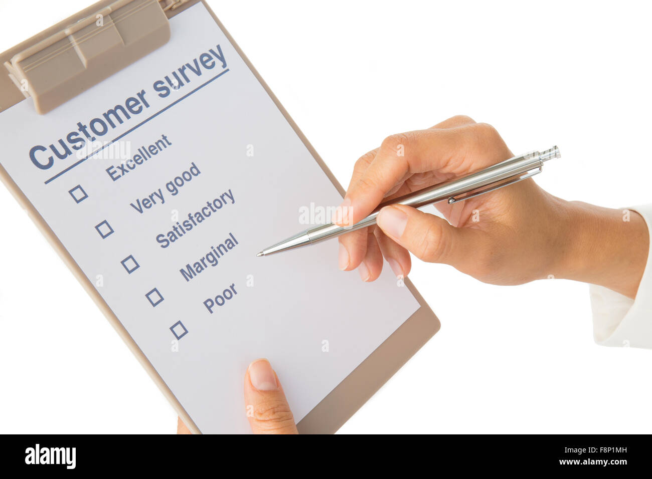 Woman's hand fills out customer survey on white - Stock Image