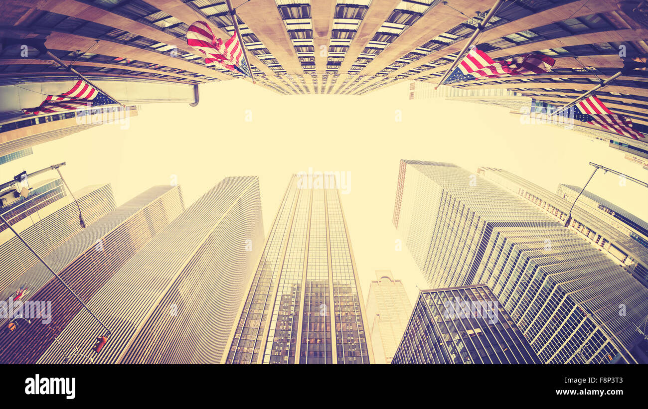 Vintage stylized fisheye lens picture of skyscrapers in Manhattan, New York, USA - Stock Image