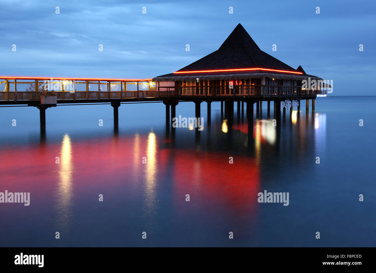 The Bodega del Mar over-water bar and restaurant in Anse Vata Bay is a cornerstone of Noumea's nightlife. - Stock Image