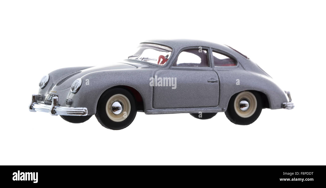 A Dinky 1958  Porsche 356A Coupe Die cast model on a white background - Stock Image