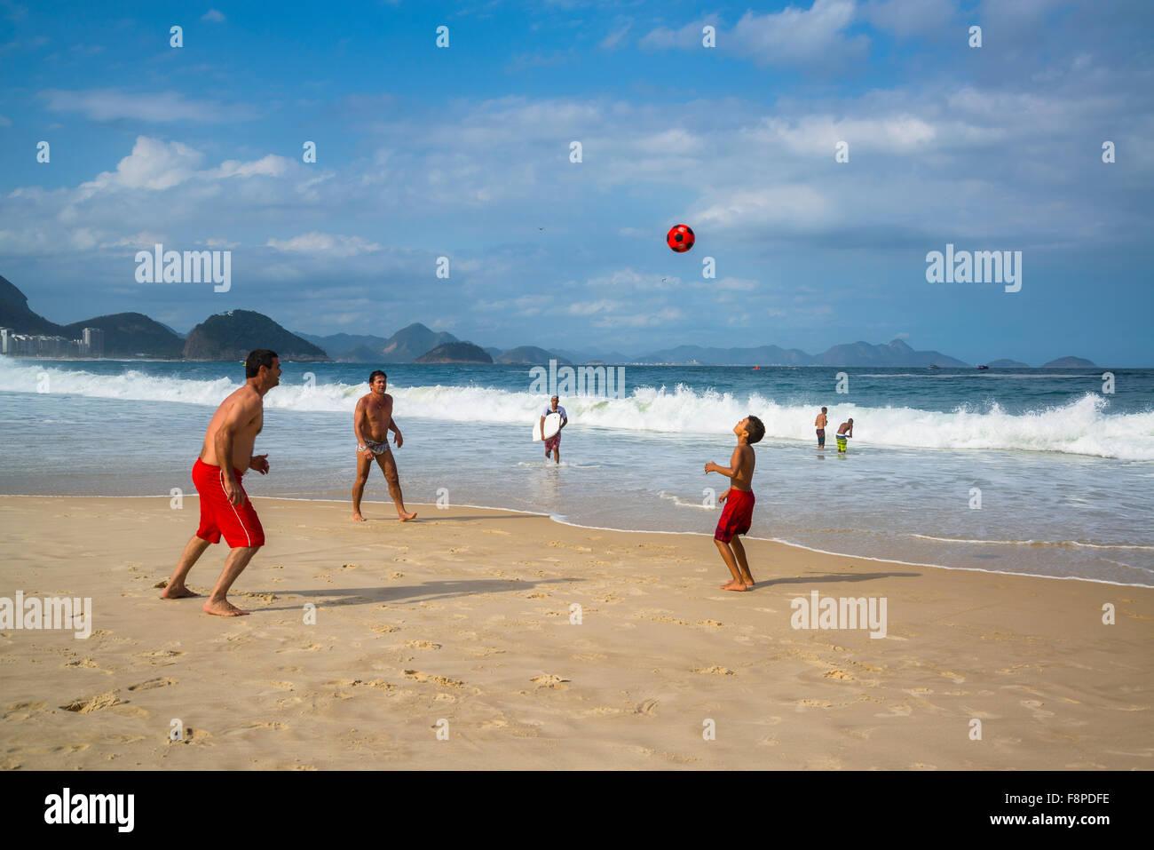 Copacabana Beach, Playing football, Rio de Janeiro, Brazil Stock Photo