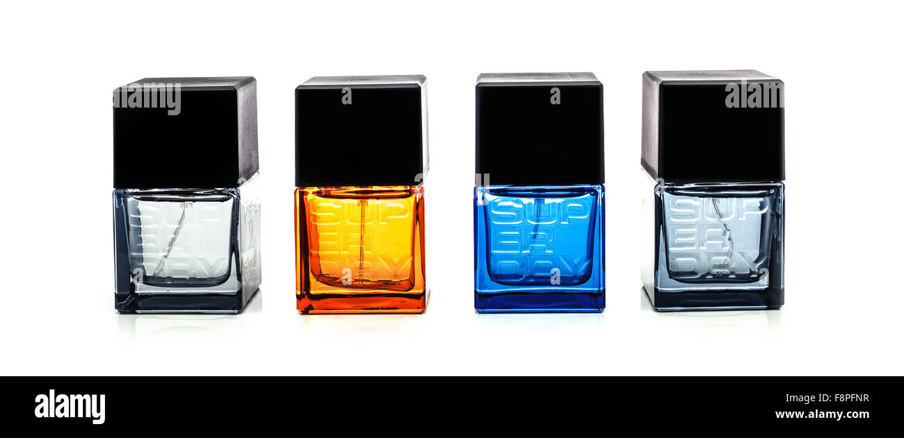 Four Bottles of Superdry Male Cologne on a White Background - Stock Image