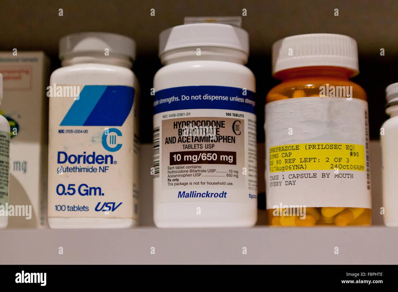 Addictive prescription medicine bottles (Doriden, Hydrocodone, Omeprazole )  - USA - Stock Image