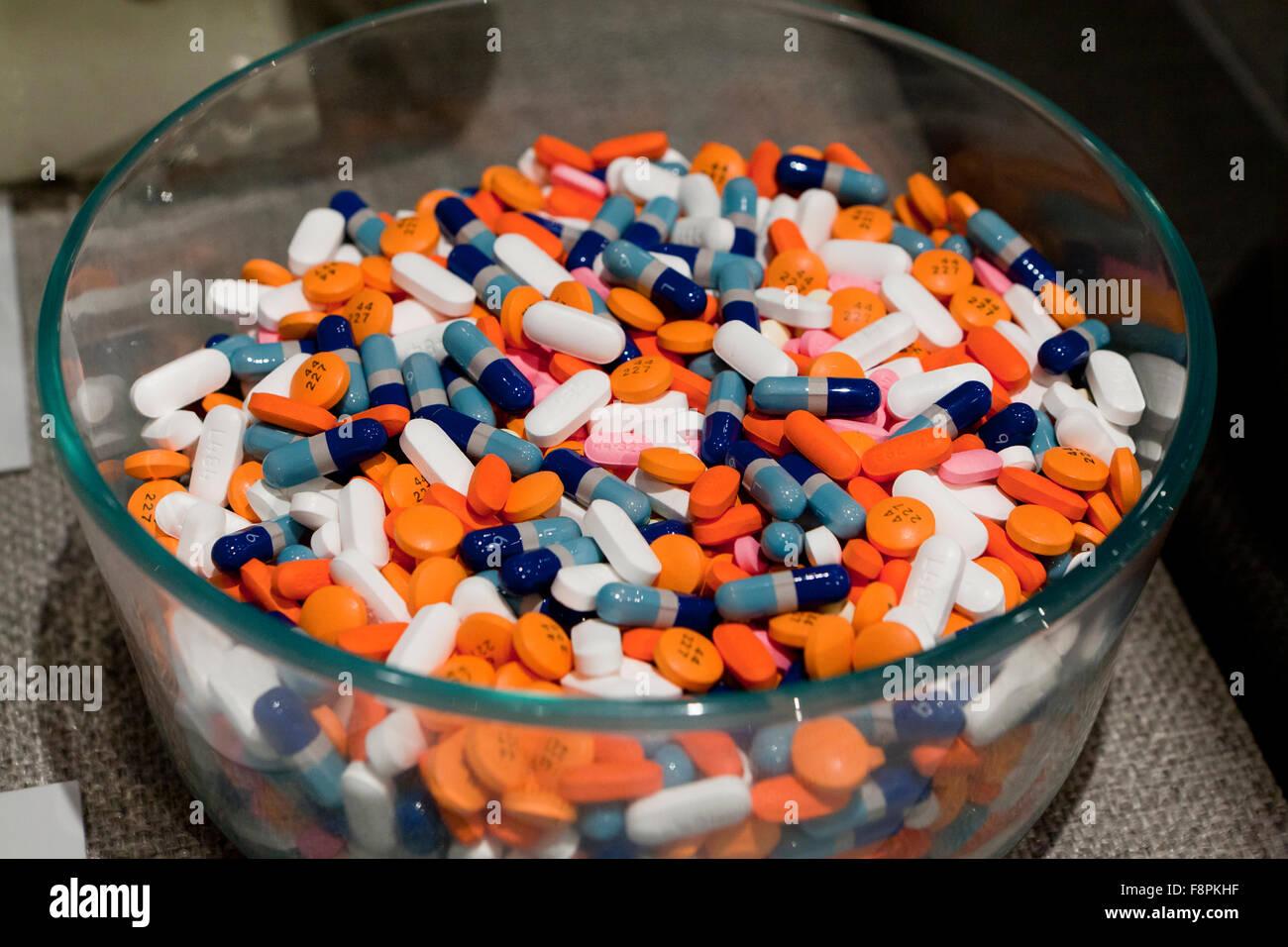 Bowl of recreational drug use pills - USA - Stock Image