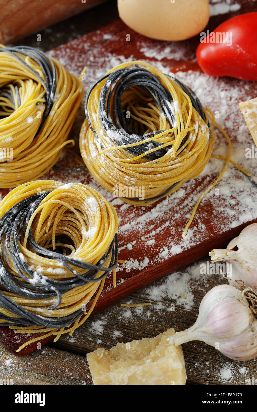 uncooked pasta with cheese and other ingredients, closeup - Stock Image