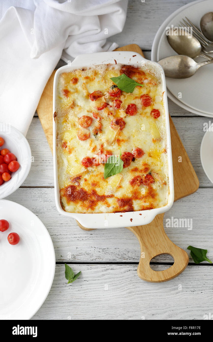 fresh lasagna with cheese in dish - Stock Image