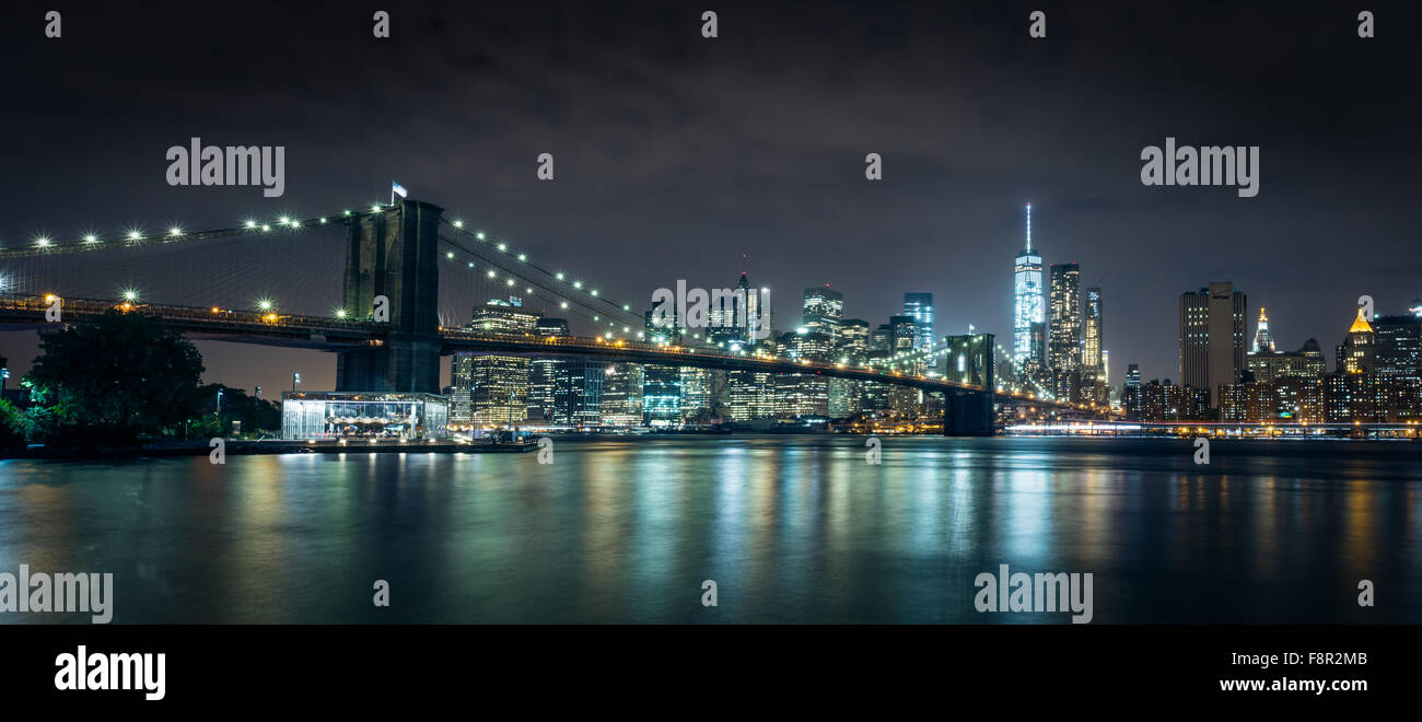 New York City  - September 29 Brooklyn Bridge night view with lights reflection in Hudson River on September 29, 2015.Brooklyn B Stock Photo