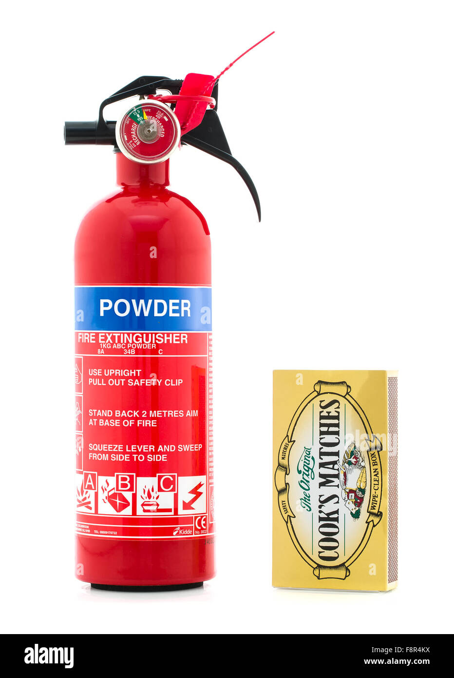 Kidde Dry Powder Fire Extinguisher With a Box of Cooks Matches on a White Background - Stock Image