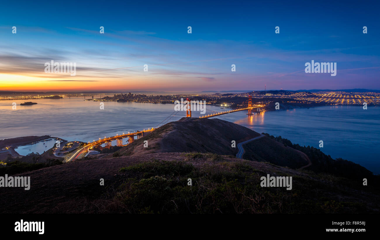 Sunrise at Golden Gate Bridge and city of San Francisco, California, USA - Stock Image