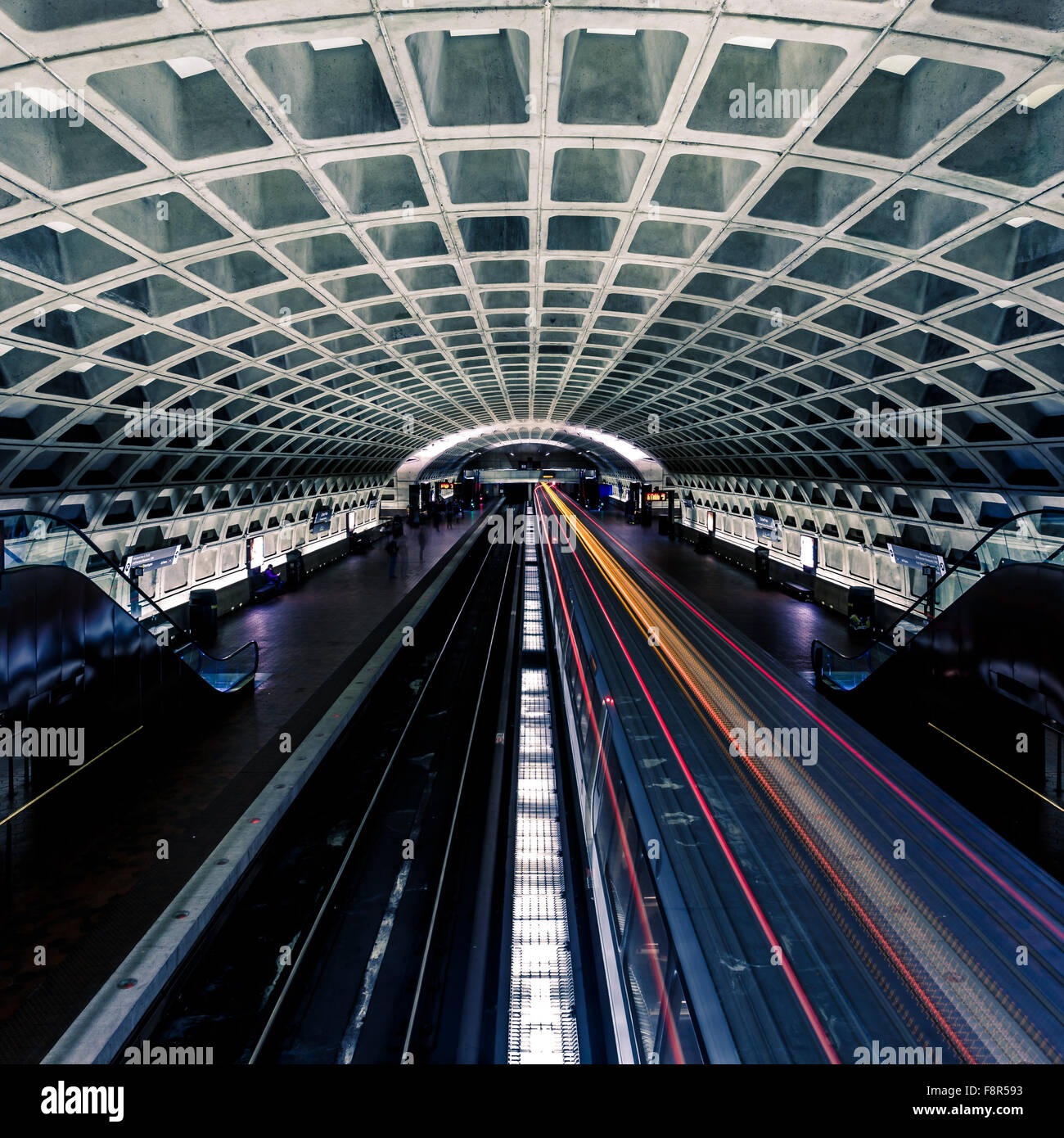 Light trail motion blur of commuter train at subway station - Stock Image