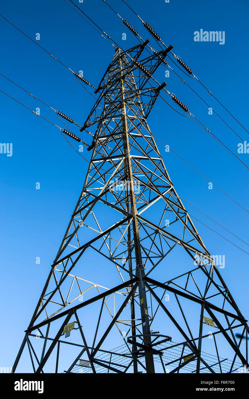 Electricity Pylon Against a Blue Sky, Mainstay Of the supply for the electricity network - Stock Image