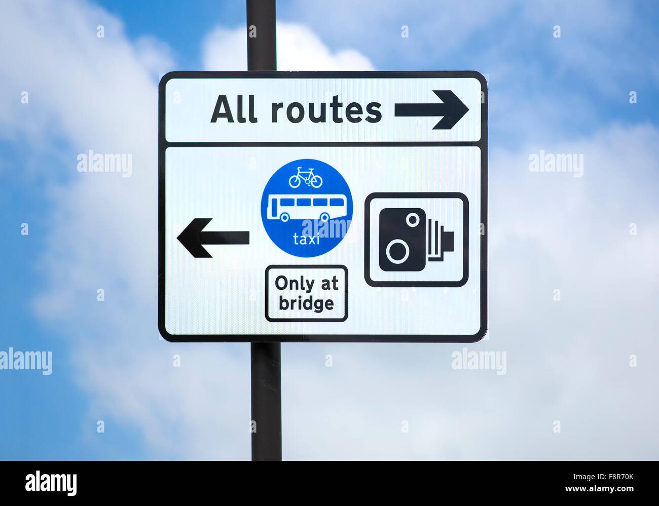 Road Sign Against Sky Showing All Routes and restrictions - Stock Image