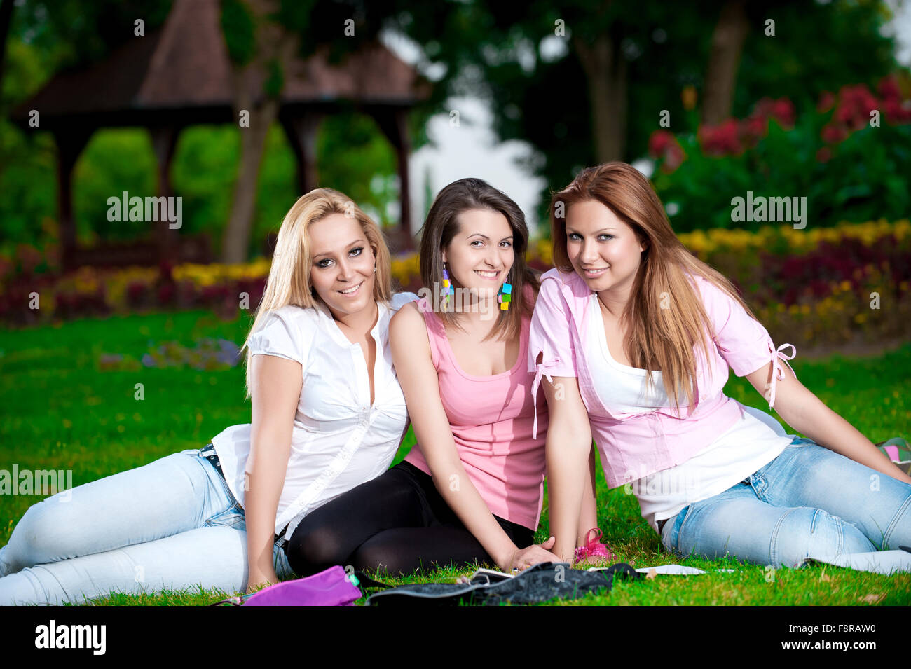 Happy Young College Girls Or High School Student Enjoy In The Park