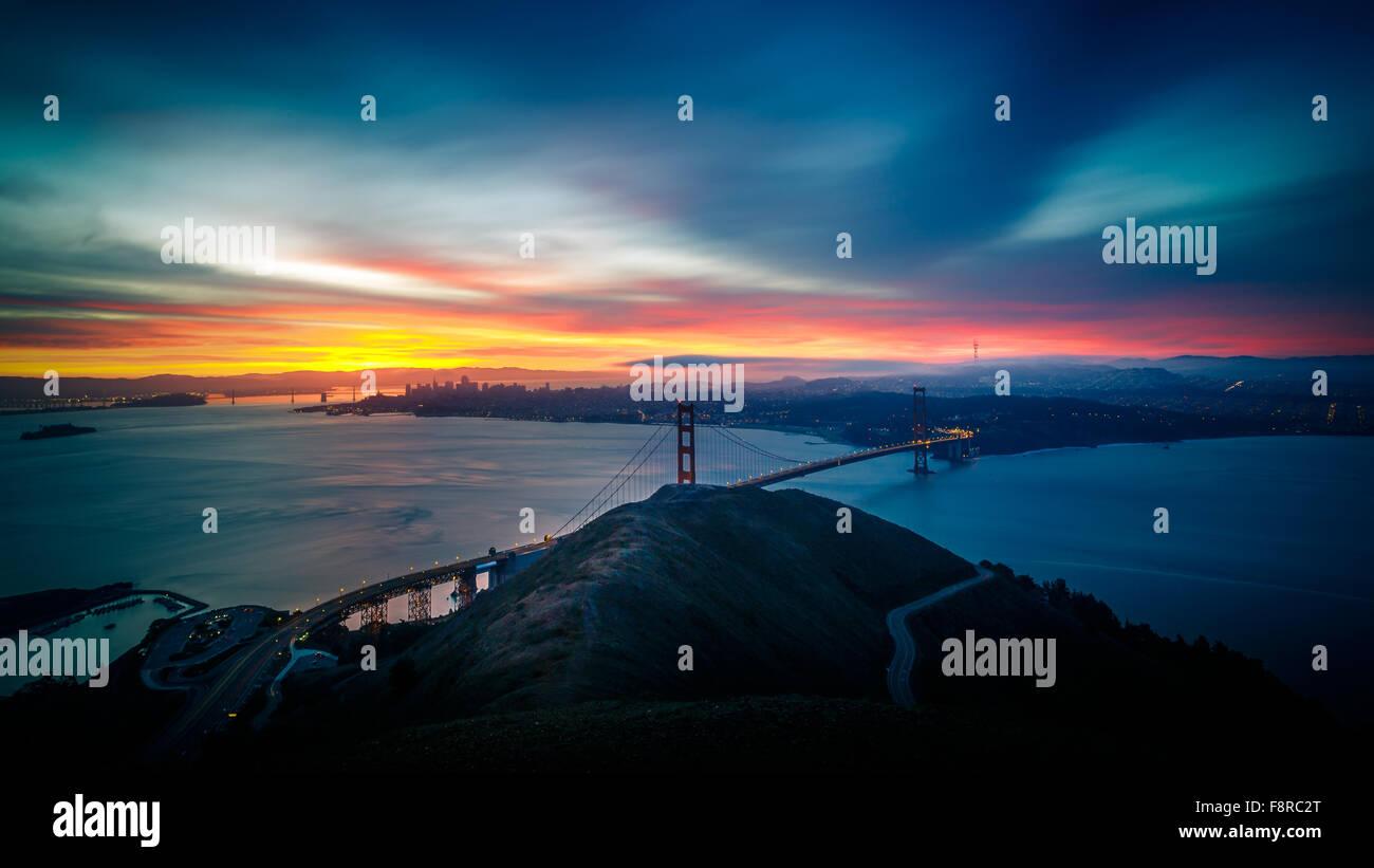 Sunrise at Golden Gate Bridge and city of San Francisco, California, USA - Stock Image