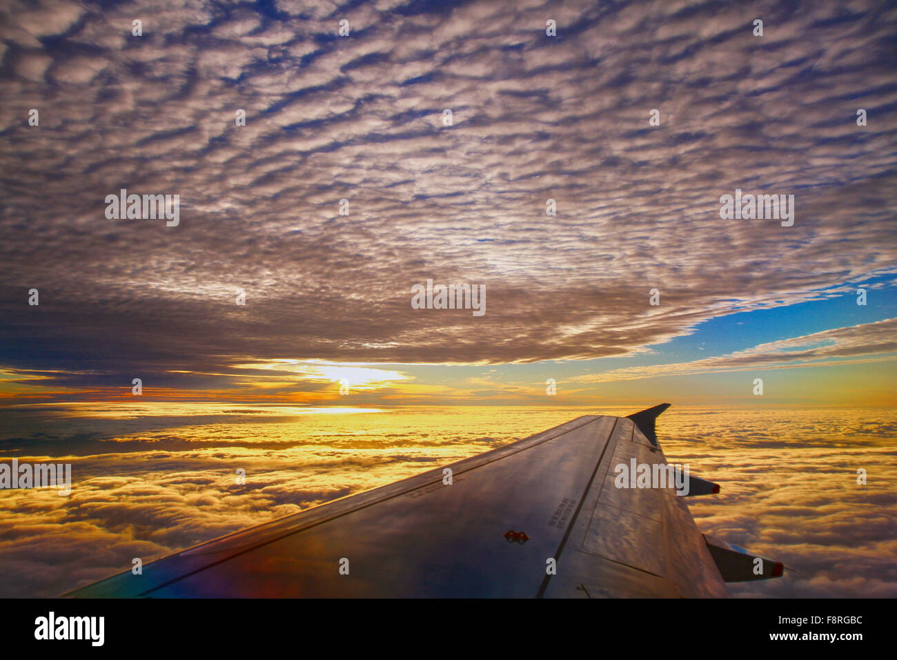 Airplane wing at sunset Stock Photo