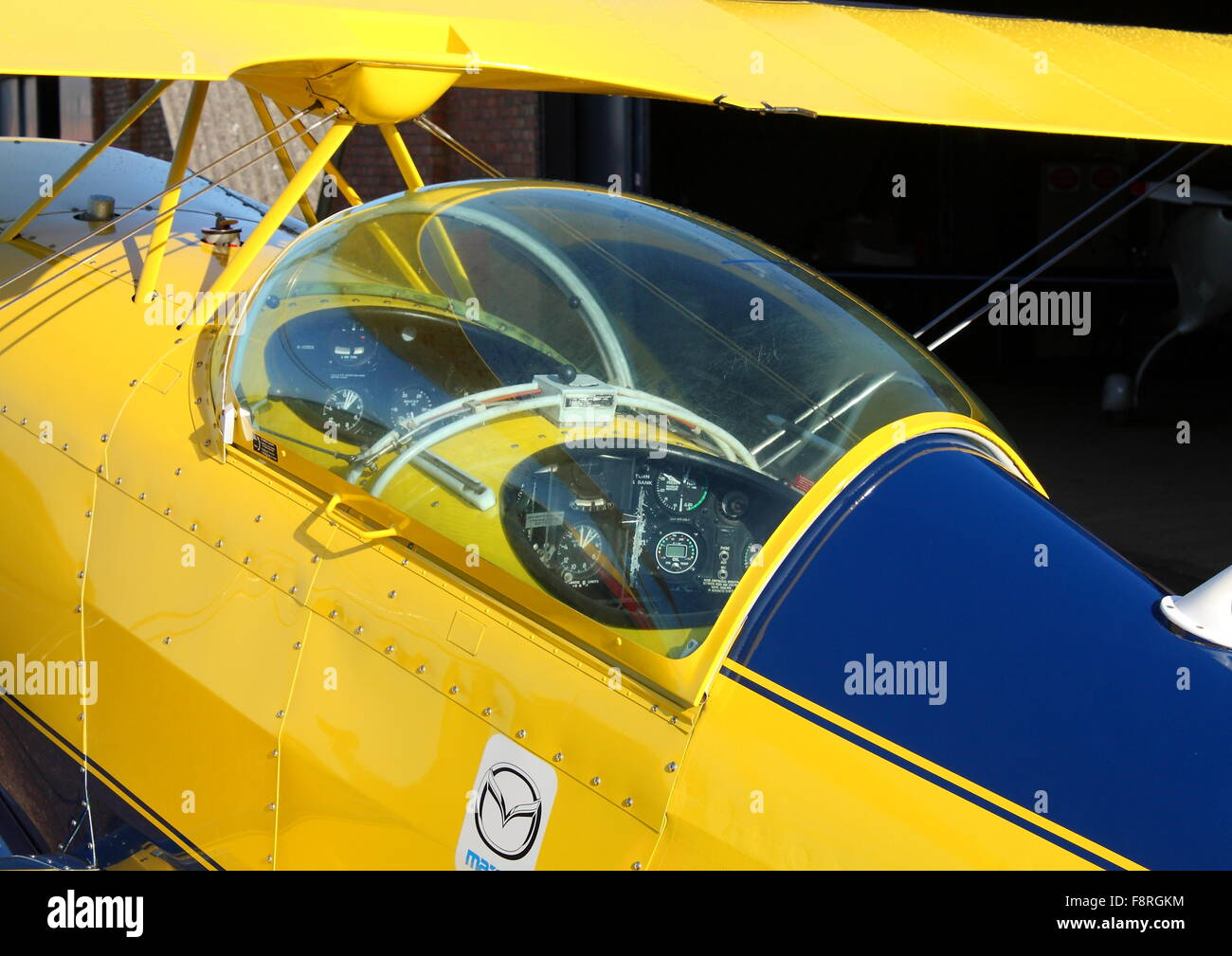 Pitts Special G-ODDS parked at White Waltham Airfield in front of a hangar - Stock Image