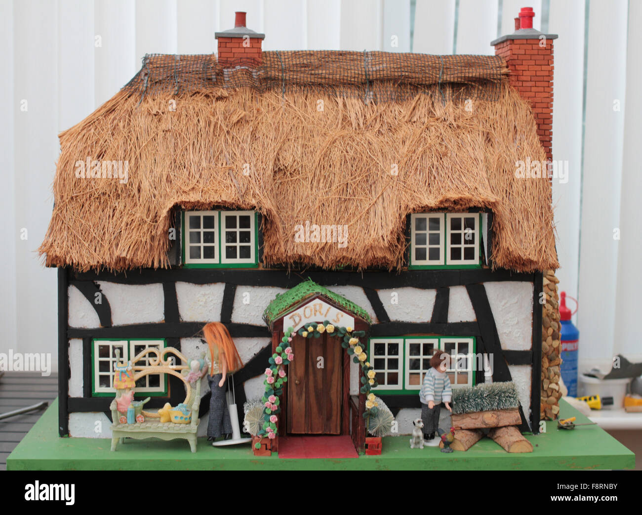 Dolls house with thatched roof - Stock Image