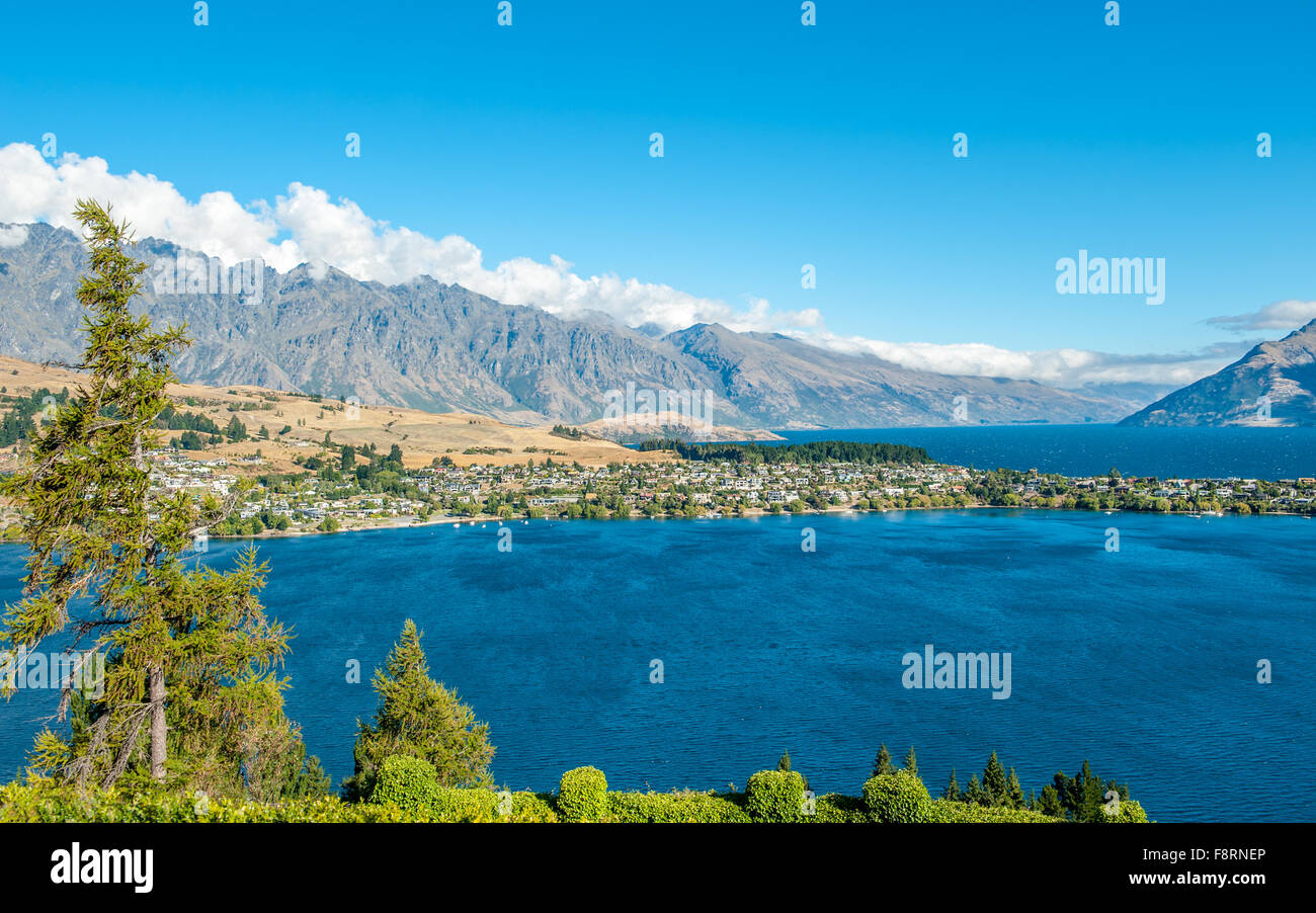 View from Queenstown toward Lake Wakatipu and the Remarkables in Central Otago, South Island, New Zealand - Stock Image