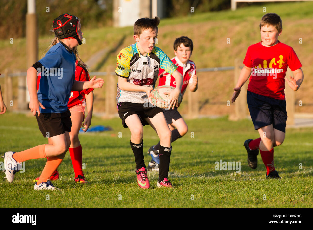 Young pre-teen boys  taking part in rugby training coaching practice, Aberaeron Wales UK - Stock Image