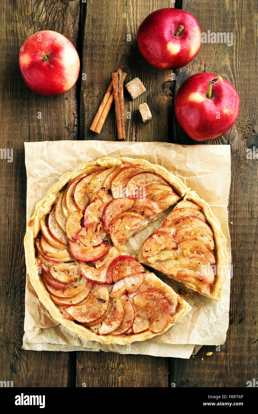 Pie with red apples on wooden table, top view - Stock Image