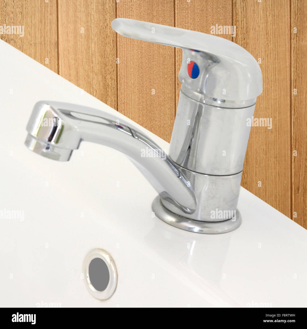 stainless steel tap and hand basin - Stock Image