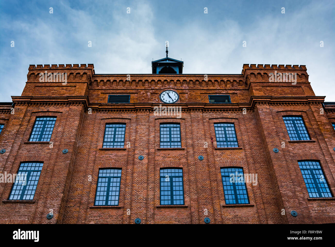 Beautifully renovated facade of an old textile factory - Stock Image