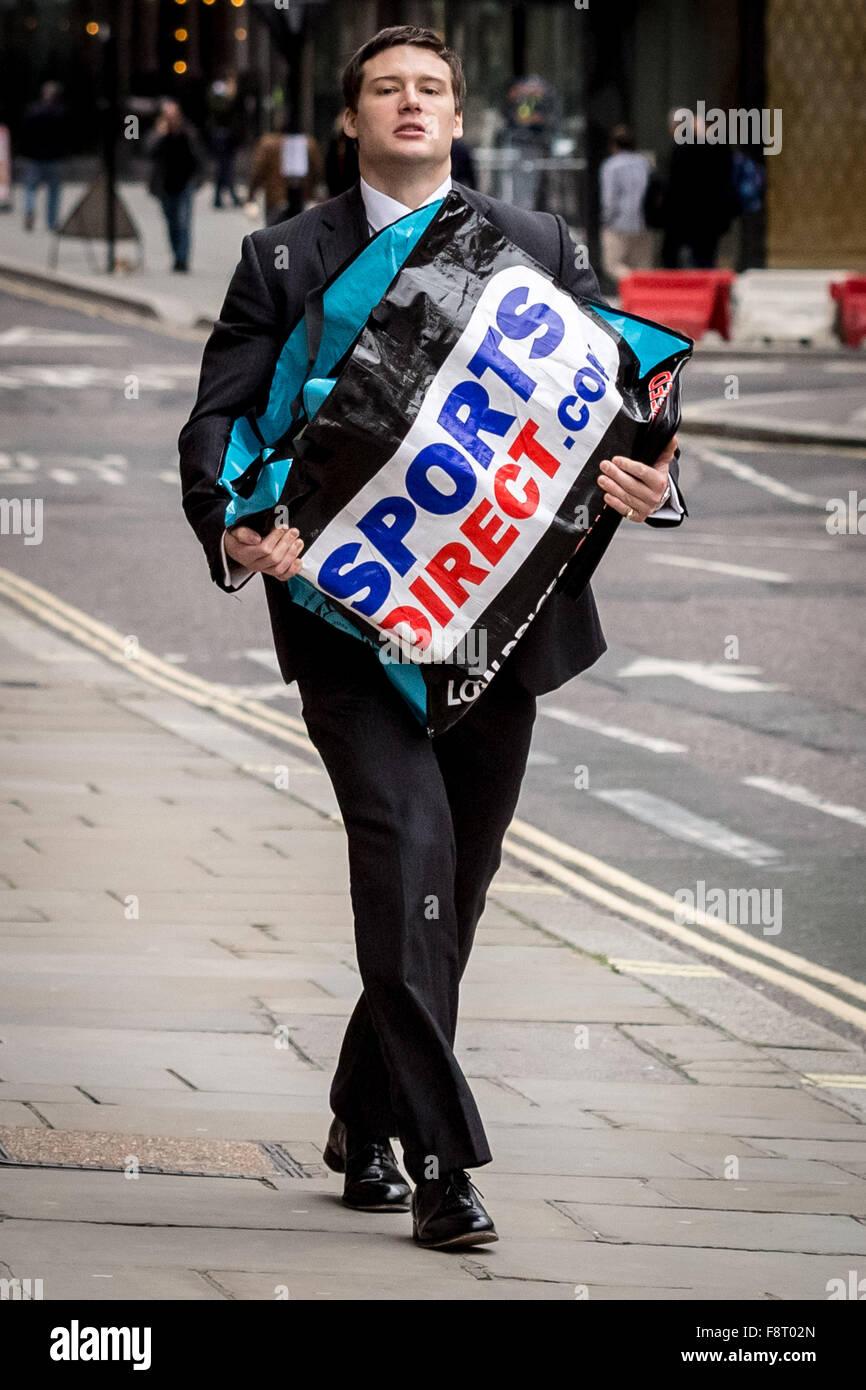 London, UK. 11th December, 2015. Sports Direct bag carried through central London. Sports Direct the UK's biggest - Stock Image