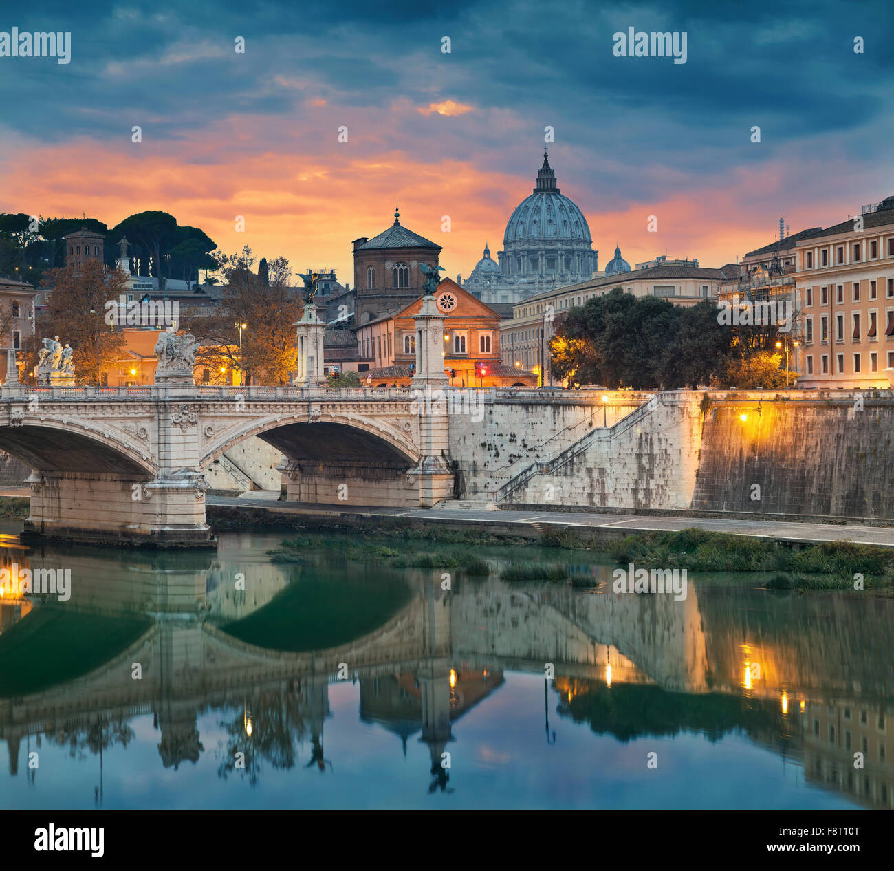 Rome. View of Vittorio Emanuele Bridge and the St. Peter's cathedral in Rome, Italy during sunset. - Stock Image
