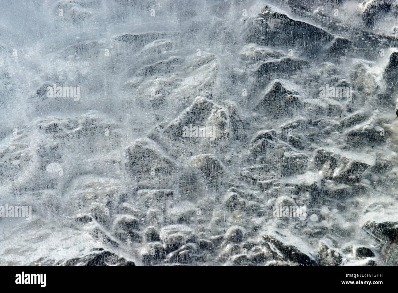 Stones under ice - Stock Image
