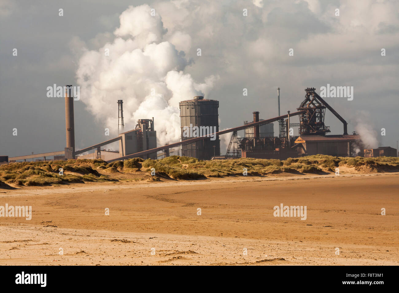 Former SSI steelworks as viewed from the beach at Redcar seafront.The company went into liquidation in October 2015 - Stock Image