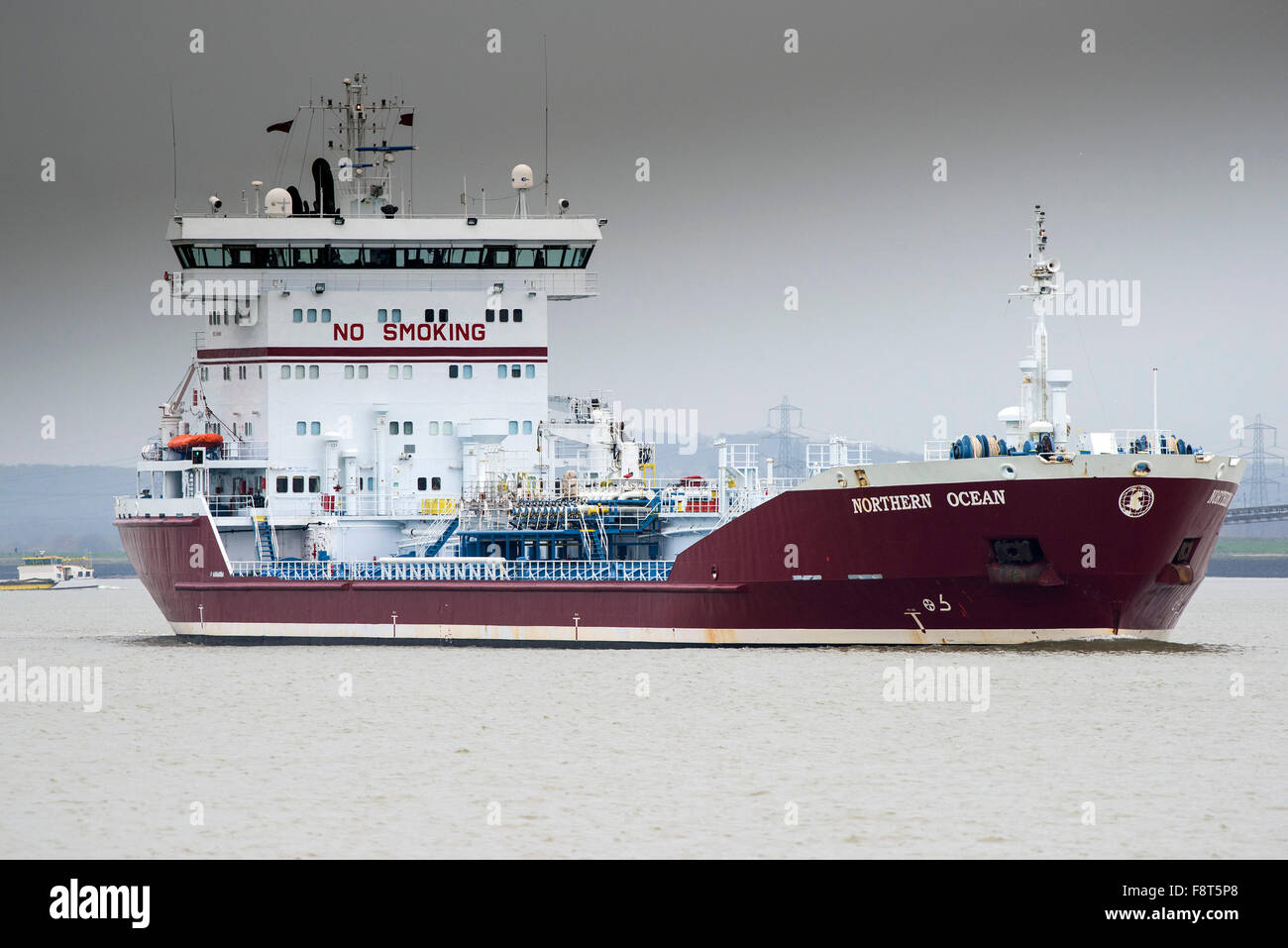 The chemical/oil products tanker, the Northern Ocean steams upriver on the River Thames. - Stock Image
