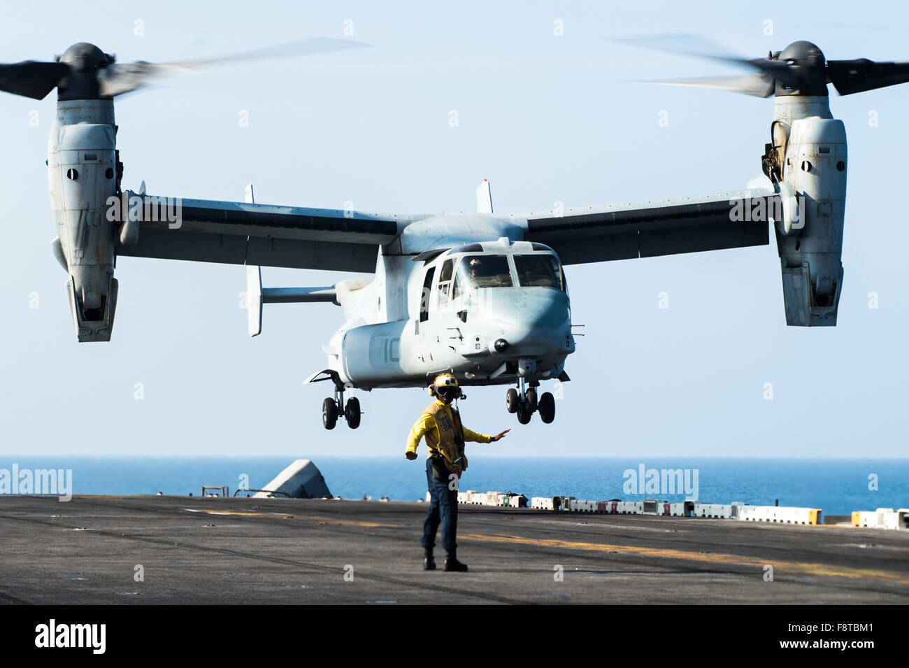 """An MV-22 Osprey from the """"Greyhawks"""" of Marine Medium-Lift Tiltrotor Squadron (VMM) 161 (Reinforced) takes off from Stock Photo"""