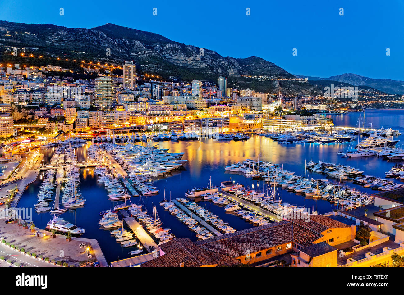 Monaco harbor at night - Stock Image